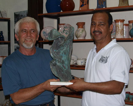 Costis gifts Ali a special piece that he made