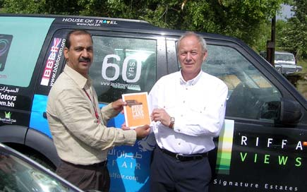'Mr Land Rover' Roger Crathorne presents Ali with a copy of his book