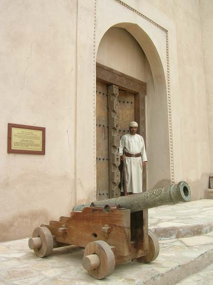Omani standing at the gate of Nizwa fort