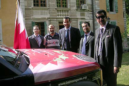 Bahrain Ambassador to the the United Nations Office in Geneva and Vienna Abdulla Abdul Latif and embassy staff looking at the tour map.